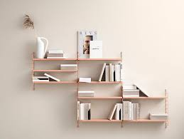 Don't leave your books lying around. Get a string shelf (stringhylla)